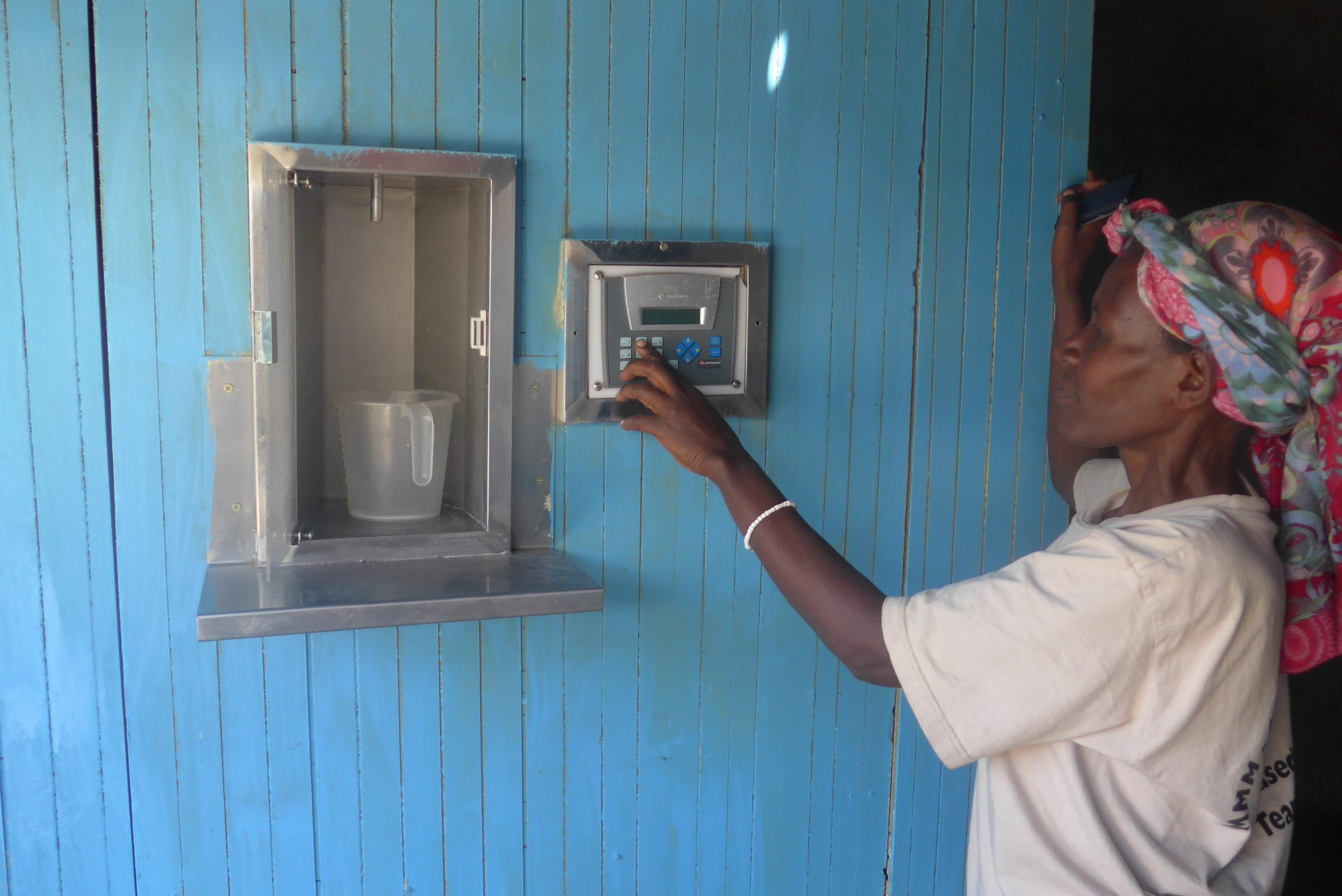 Jane with her new automatic milk ATM
